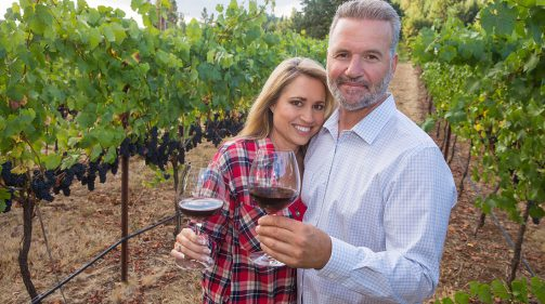 Happy, attractive couple at a wine vineyard